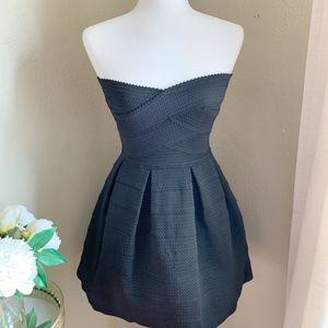 B. Darlin Black Textured Strapless Dress